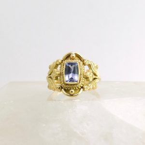 18k yellow gold ring with bezel set lavender sapphire