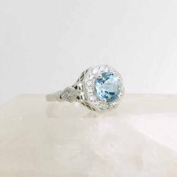 14k white gold ring with 9mm blue topaz and diamonds