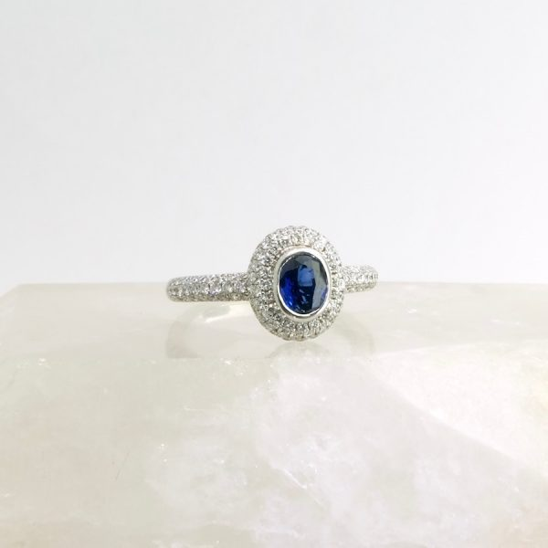 18k white gold ring with oval sapphire and diamonds