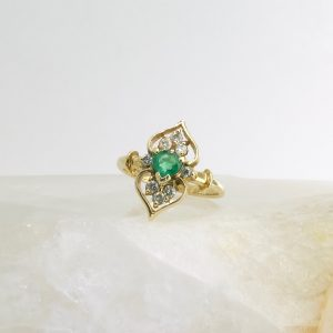 14k yellow gold ring with heart shaped emerald and diamonds