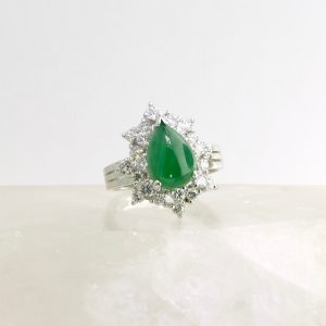 14k white fold ring with pear shaped jade cabochon and diamonds