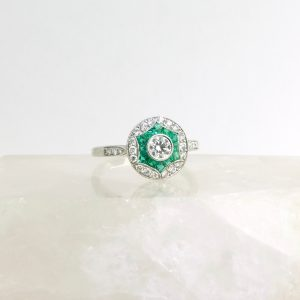 platinum ring with emeralds and diamonds