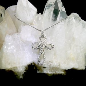 18k white gold diamond cross pendant on diamond cut rope chain