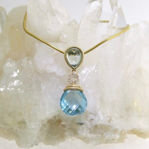 14k yellow gold necklace with blue topaz drop pendant and diamonds