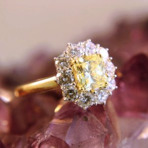 yellow center diamond with white diamond halo
