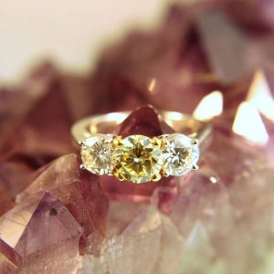 yellow and white diamond three stone ring