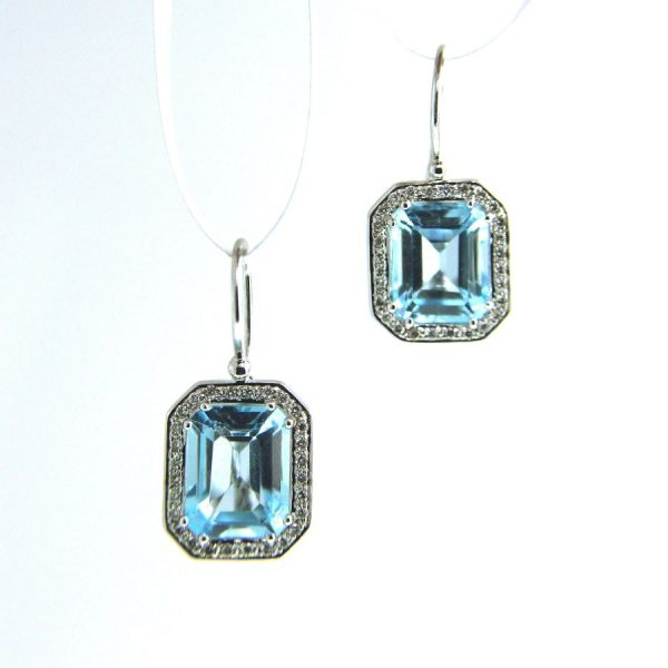 white gold blue topaz earrings with diamonds
