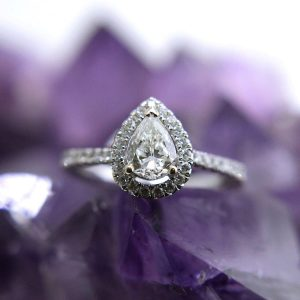 14k white gold ring with a 0.67 carat pear cut sI 2 diamond color I