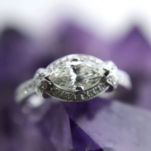 14k white gold ring with 0.89 carat color J SI2 marquise center diamond