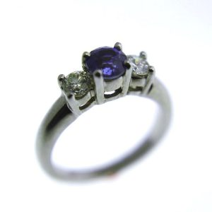 14k white gold ring with 1.04 carat sapphire and 2 diamonds at 0.44 carats