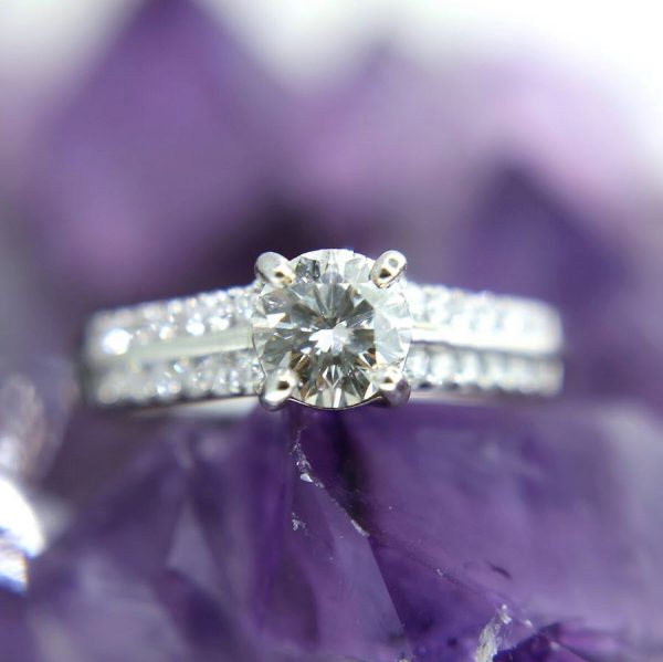 18k white gold ring with 0.71 carat center stone and 24 diamonds at 0.29 carats total