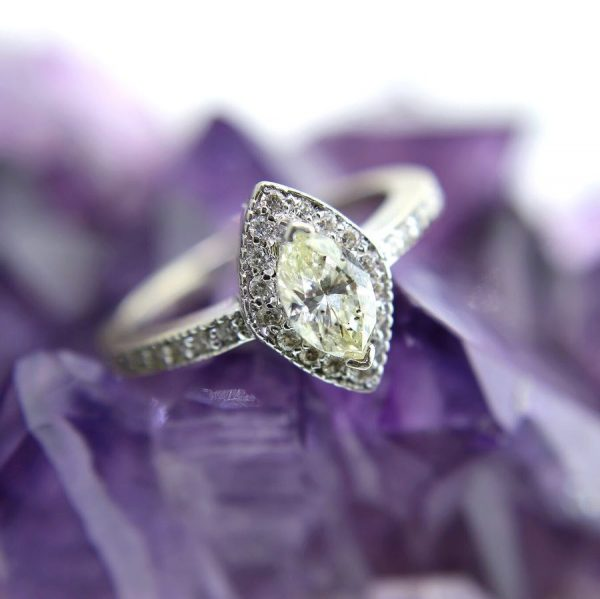 14k white gold with a 0.71 carat yellow marquise diamond