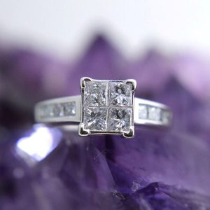 14k white gold ring with 16 princess cut diamonds totaling 1.40 carats
