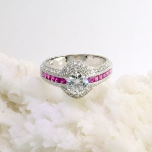 14k white gold ring with .77 ct center diamonds, rubies, and accent diamonds