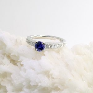 18k white gold ring with .48 ct sapphire and diamonds .18 cttw