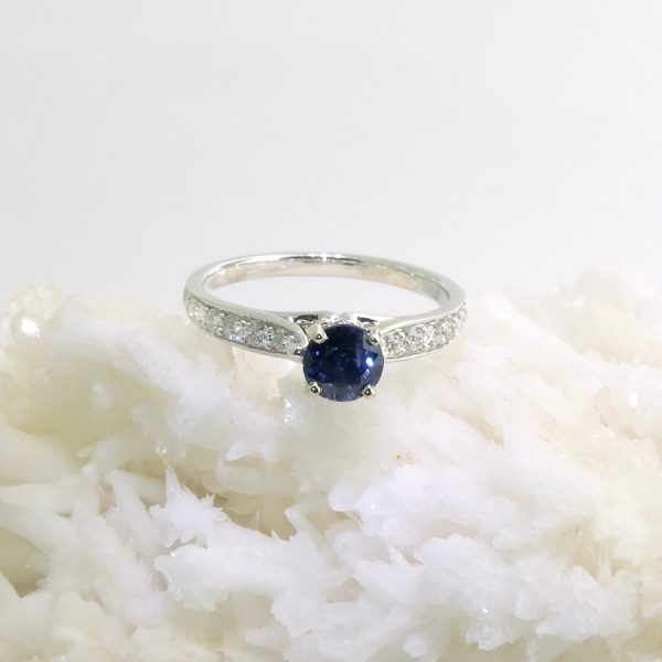 18k white gold ring with .87 ct sapphire and accent diamonds .25 cttw