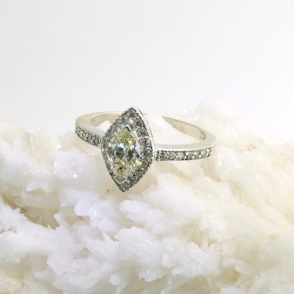 14k white gold ring with .71 yellow marquise diamond and pave set diamonds