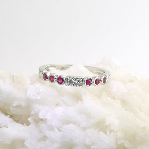 14k white gold band with 6 diamonds .14 cttw and 6 rubies .21 cttw