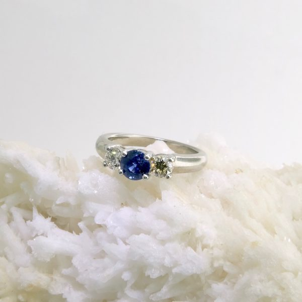 14k white fold ring with 1.04 ct sapphire and two side diamonds .44 cttw