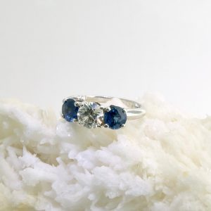 14k white gold ring with 1.01 ct diamond and 2 sapphires 1.75 cttw