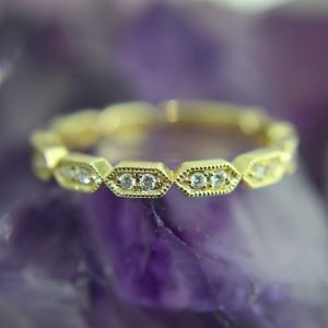yellow gold wedding band with 20 bead set diamonds, .15 TCW
