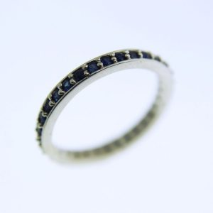 Wedding Band with 32 Bead Set Sapphires
