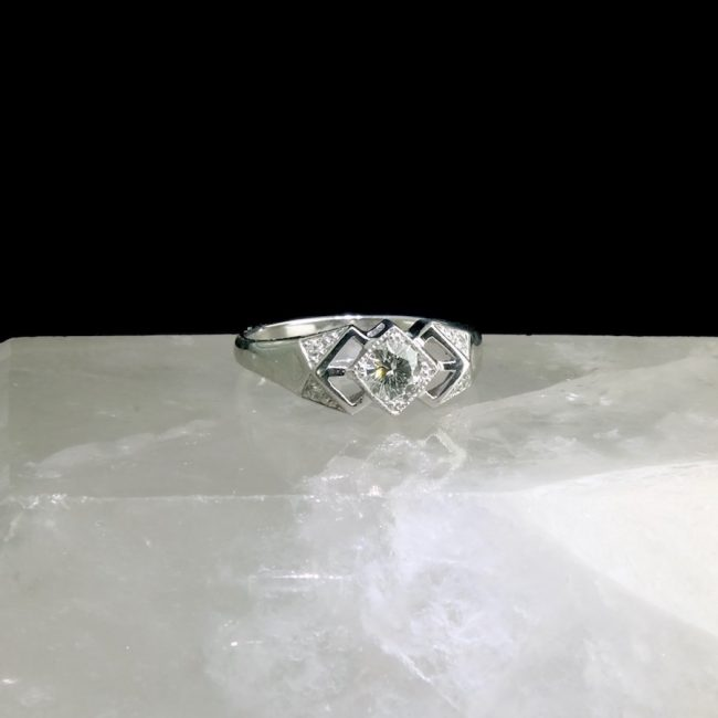 14k white gold ring with .38 ct center diamonds and .04cttw accent diamonds