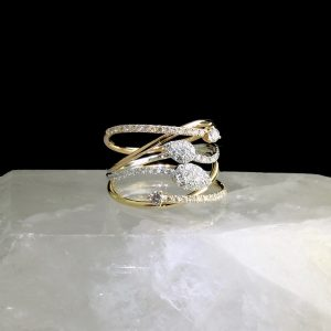 18 three tone gold ring with diamonds