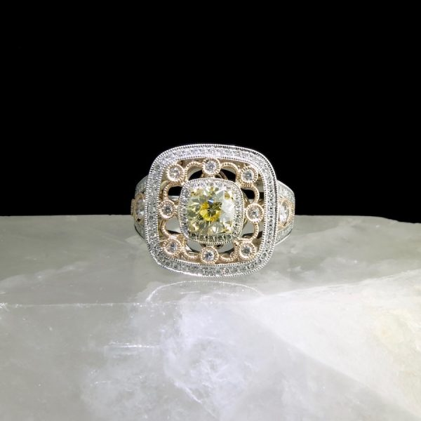 14k white and rose gold ring with yellow center diamond and 108 accent diamonds