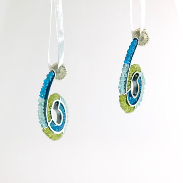 Sterling silver spiral earrings with peridot, blue topaz, and apatite Kinzig Design